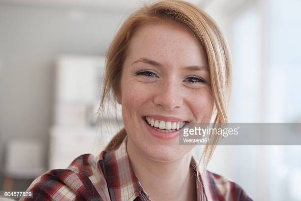 Portrait of happy young woman with freckles