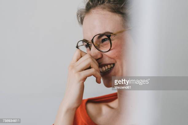 Portrait of happy young woman with glasses