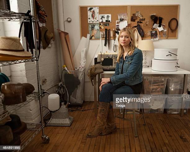 Portrait of hat designer in her studio