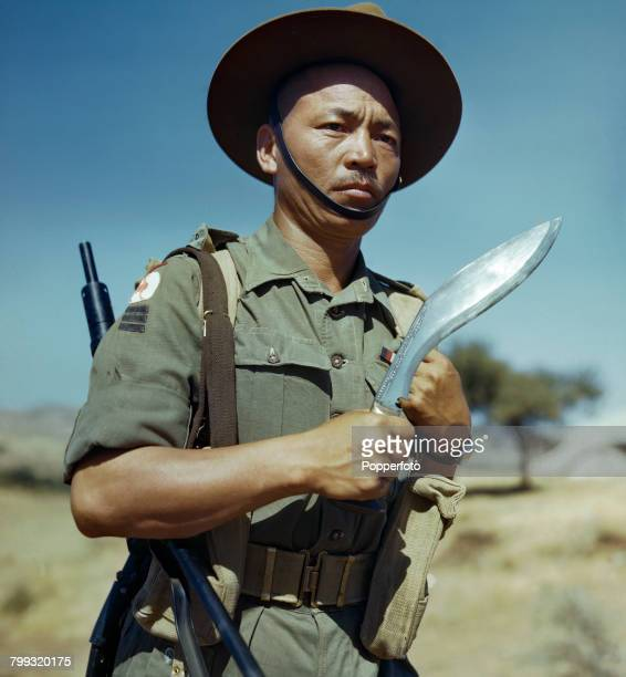 Portrait of Havildar Kulbahadur Gurung of a Gurkha regiment of the 23rd Indian Infantry Division of the British Army World War II pictured holding...