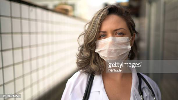 portrait of health visitor during home visit - prevention stock pictures, royalty-free photos & images