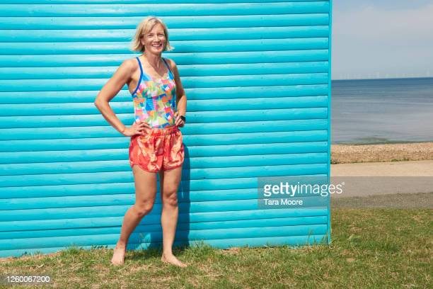 portrait of healthy mature woman smiling - multi coloured stock pictures, royalty-free photos & images