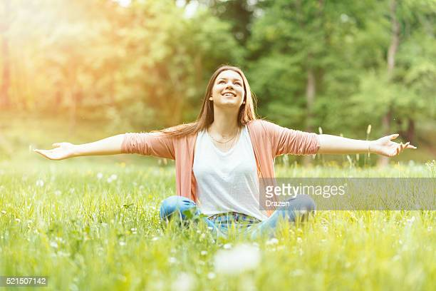 Portrait of healthy woman enjoying sunny spring day in nature