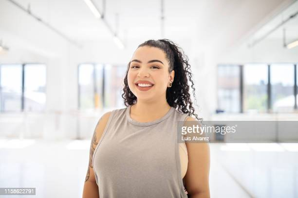 portrait of healthy woman in dance class - plus size model stock pictures, royalty-free photos & images