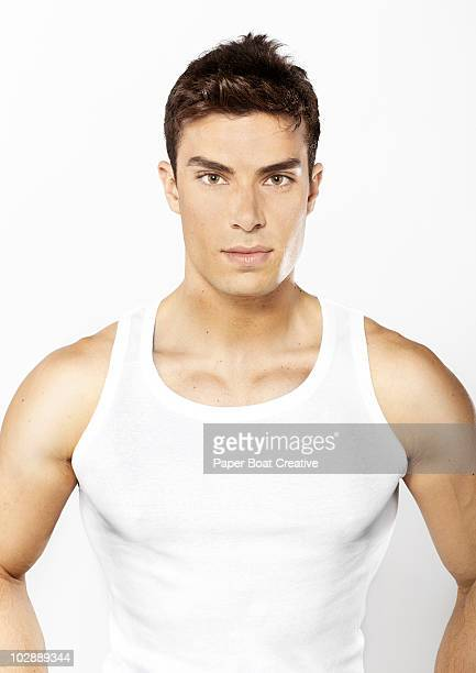 portrait of healthy young man in the studio - vest stock pictures, royalty-free photos & images