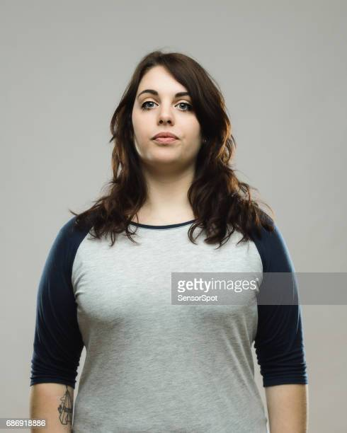Portrait of healthy young woman on gray background