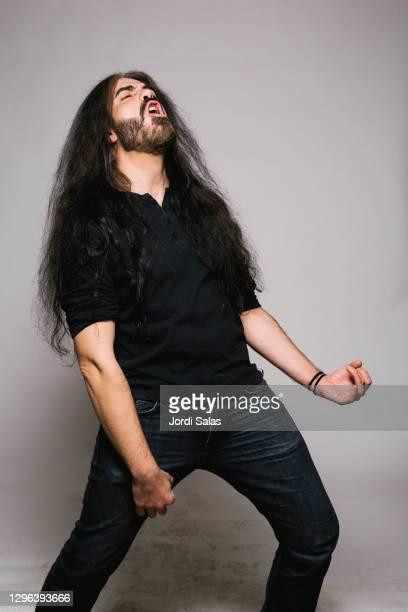 portrait of heavy metal man singing - heavy metal stock-fotos und bilder