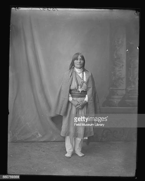 Portrait of Hessosita Suasa, a Native American Santa Clara woman wearing a cloth dress, strings of beads, and a silver cross at the Louisiana...