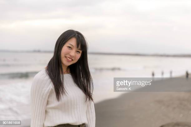 portrait of high school girl standing on beach - beautiful japanese girls stock photos and pictures