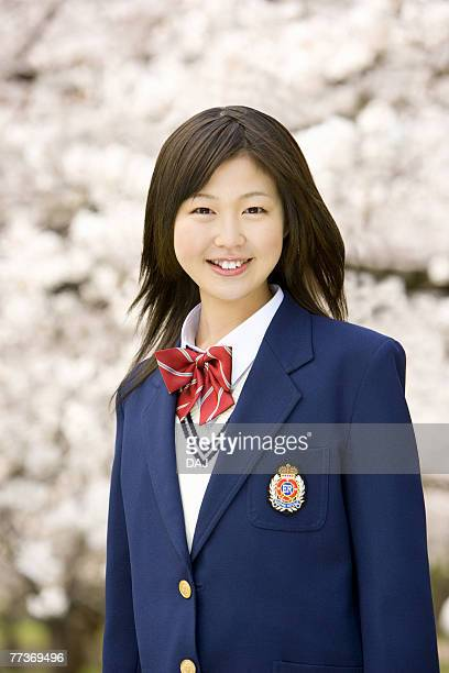 Portrait of high school girl with cherry blossoms in the background