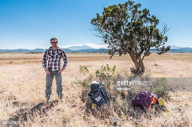 Portrait of hiker resting by a tree, Arizona, America, USA