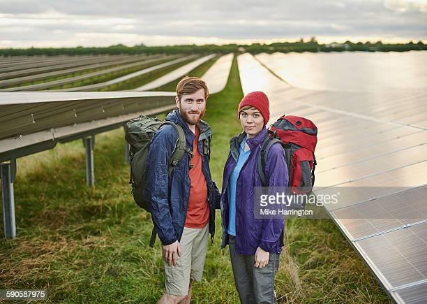 Portrait of hikers in solar farm