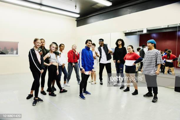 portrait of hip hop dance group in dance studio after practice - dance troupe stock photos and pictures