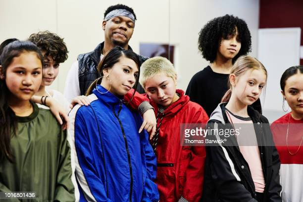 Portrait of hip hop dance group in studio after practice