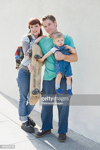 Portrait of hipster family with skateboard