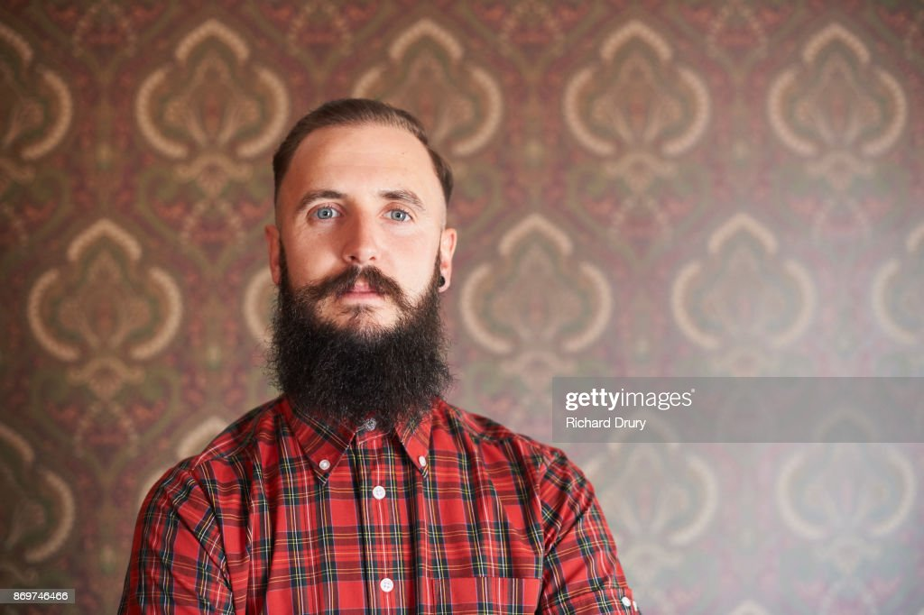 Portrait of hipster in his front room : Stock Photo