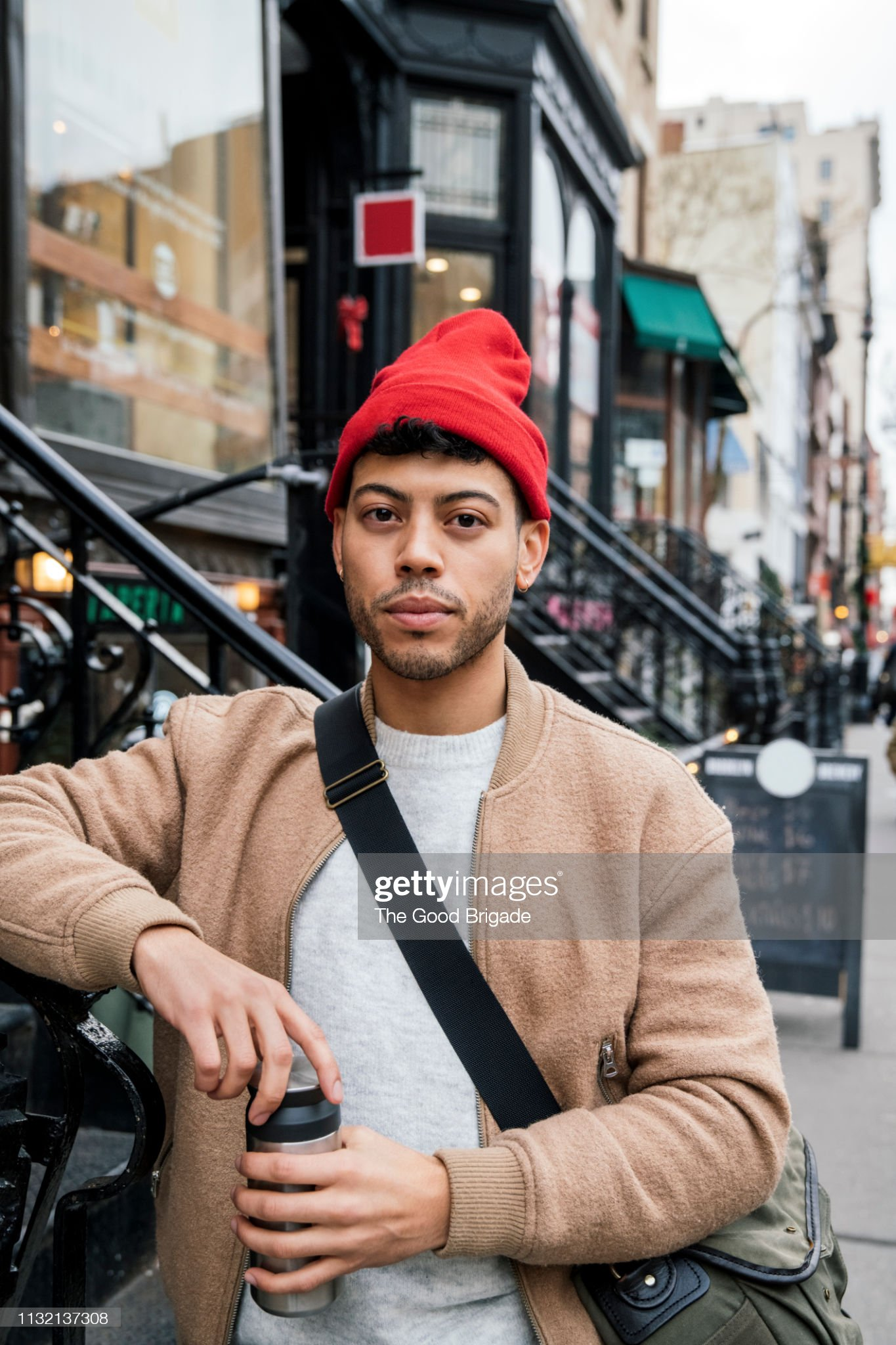 Portrait of hipster man standing on city street : Stock Photo