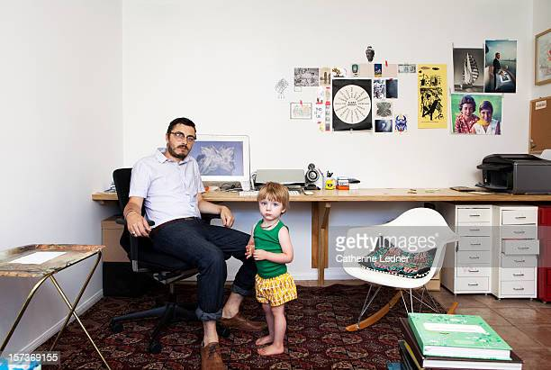 Portrait of hipster with toddler in home offic