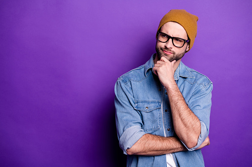 Portrait of his he nice attractive doubtful bearded guy touching chin thinking guessing strategy copy space isolated over bright vivid shine violet lilac purple background 1165537740