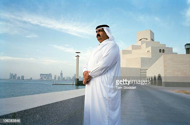 A portrait of His Highness the Emir Sheikh Hamad bin Khalifa AlThani outside the new Museum of Islamic Art in Doha Qatar The country's huge oil and...