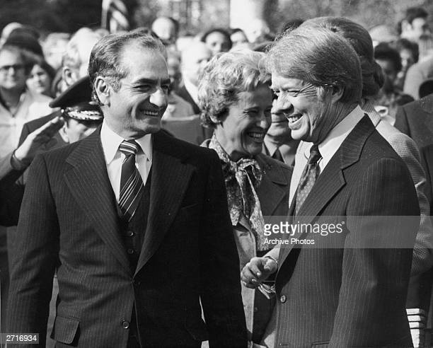 Portrait of His Imperial Majesty the Shah of Iran smiling with President Jimmy Carter, Washington, DC.