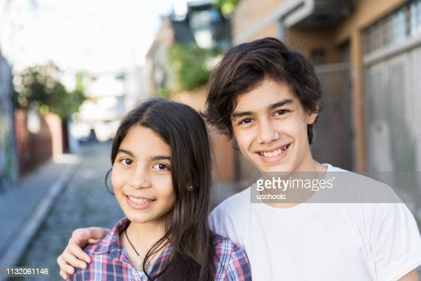 portrait of hispanic boy and girl - sister stock pictures, royalty-free photos & images
