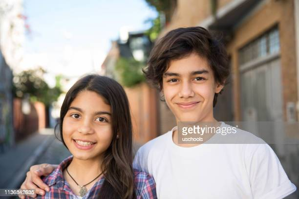portrait of hispanic boy and girl - brother stock pictures, royalty-free photos & images