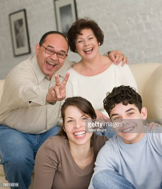 Portrait of Hispanic family being silly