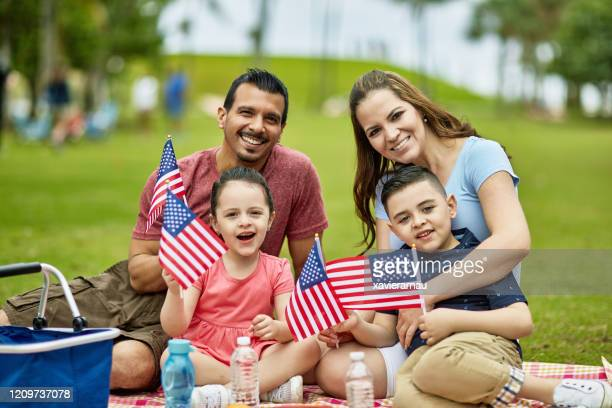 portrait of hispanic family celebrating american holiday - fourth of july stock pictures, royalty-free photos & images