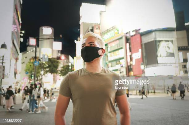 portrait of hispanic man wearing protective face mask - kyonntra stock pictures, royalty-free photos & images
