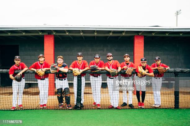 portrait of hispanic nine-man baseball team lined up to play - baseball team stock pictures, royalty-free photos & images
