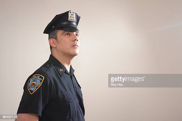 portrait of hispanic police officer - police uniform stock pictures, royalty-free photos & images