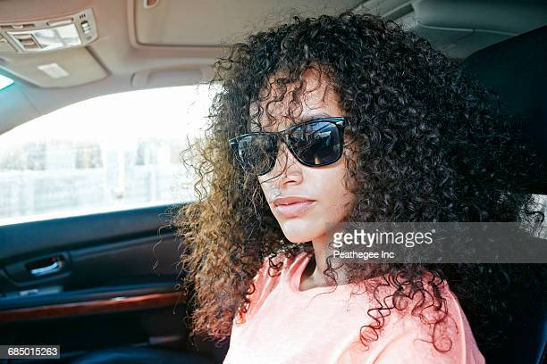 Portrait of Hispanic woman driving car