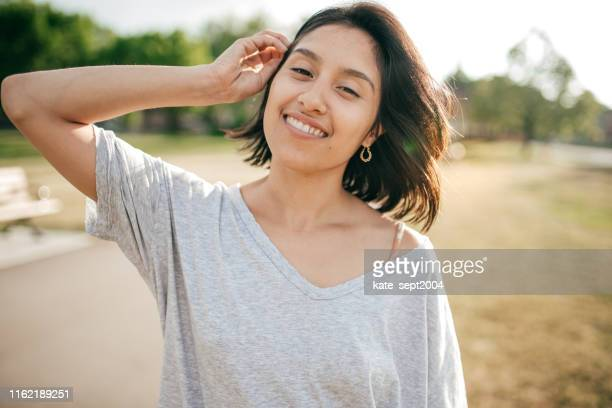 portrait of hispanic women - resilience stock photos and pictures