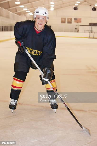 Portrait of hockey player in ring