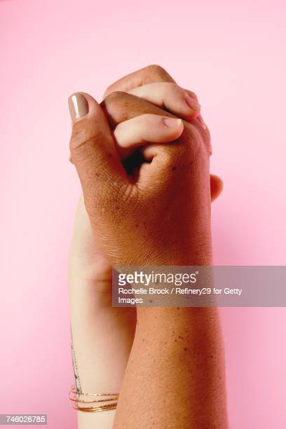 portrait of holding hands - noapologiescollection stock pictures, royalty-free photos & images