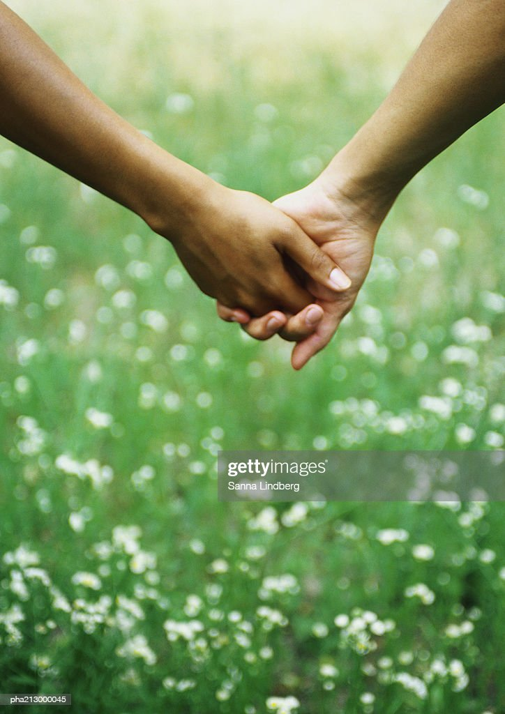 Portrait of holding hands : Stockfoto