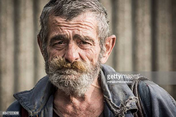 portrait of homeless man - human arm stockfoto's en -beelden