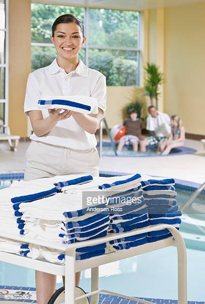 Portrait of hotel staff handing out towels