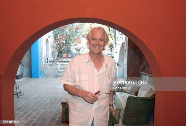 Portrait of hotelier John Stewart as he stands under an archway on his coowned property Hotel California Todos Santos Baja California Mexico February...