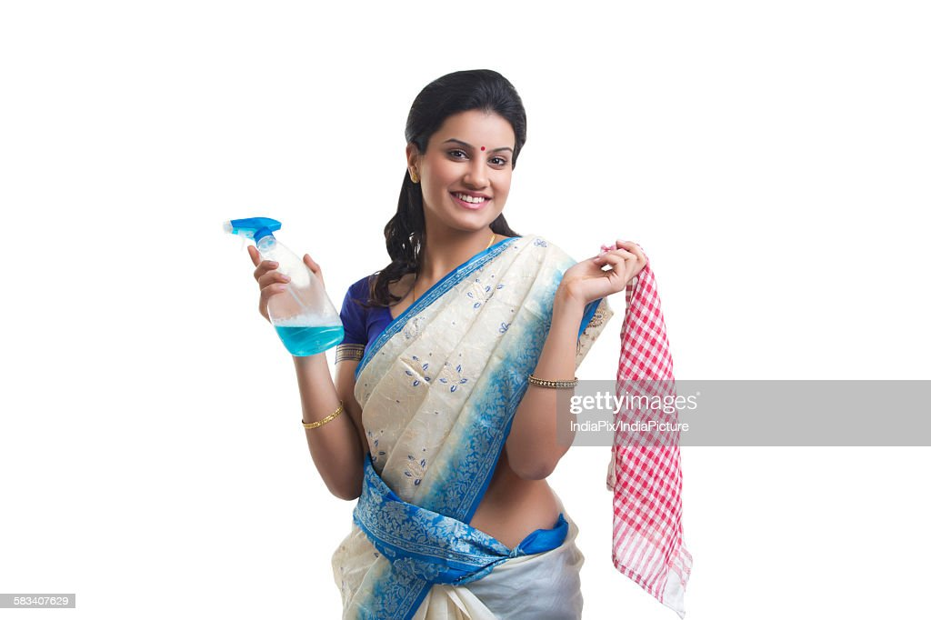 Portrait of housewife with spray bottle and cloth : Stock Photo