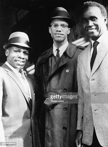 Portrait of human rights activist Malcolm X with Zambian President Kenneth Kaunda and another man in Harlem New York circa 1964