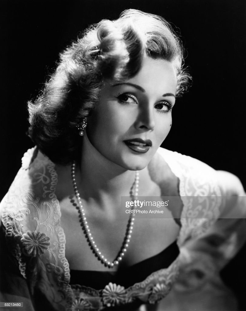 Portrait of Hungarian actress Zsa Zsa Gabor wearing a lace shawl and a strand of pearls, August 10, 1952.