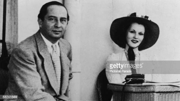 Portrait of Hungarian actress Zsa Zsa Gabor wearing a wide brimmed hat and smiling with her husband Turkish diplomat Burhan Belge Ankara Turkey 1940