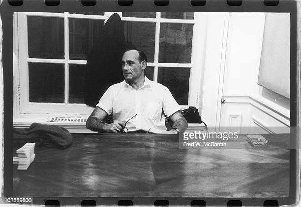 Portrait of Hungarian art gallery owner Tibor de Nagy as he sits behind a desk in his gallery New York New York October 11 1960