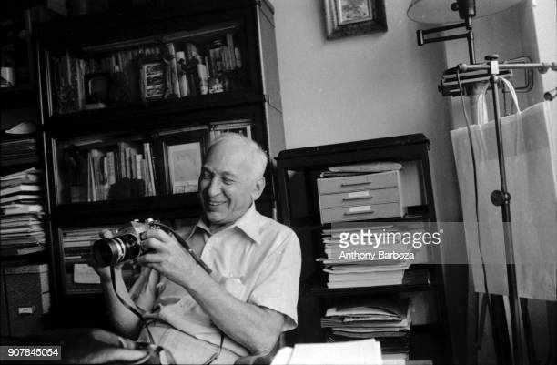Portrait of Hungarianborn American photographer Andre Kertesz as he sits at his desk with his camera New York September 20 1974
