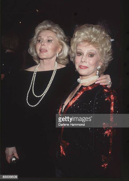 Portrait of Hungarianborn American sisters actresses Zsa Zsa Gabor and Eva Gabor as they pose together at a party at Bistro Gardens Beverly Hills...