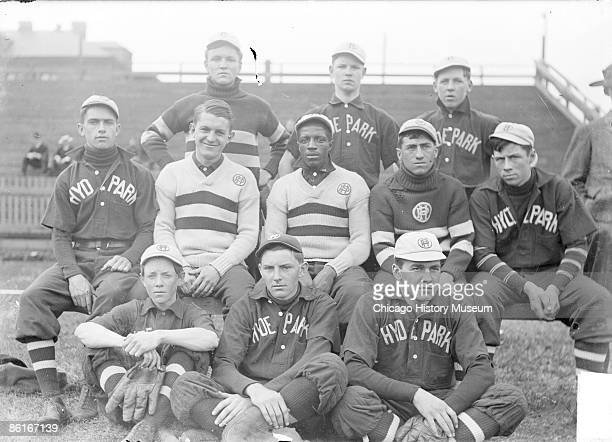 Portrait of Hyde Park High School baseball team, eleven members, wearing uniforms, sitting in three rows outdoors on the field in Chicago, Illinois,...