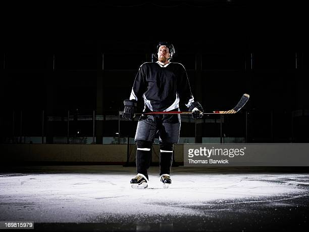 Portrait of ice hockey player standing on ice