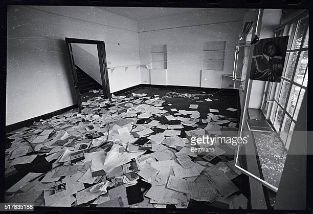 Portrait of Idi Amin still hangs in the window while secret files lay scattered all over the floor at the dreaded State Research Bureau's...